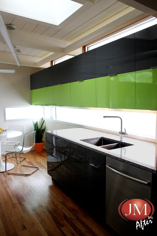 Another view of the stunning JM Semi Custom Kitchen using the most popular color this year a beautiful green.