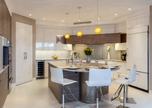 Contemporary Denver kitchen features white glass cabinets