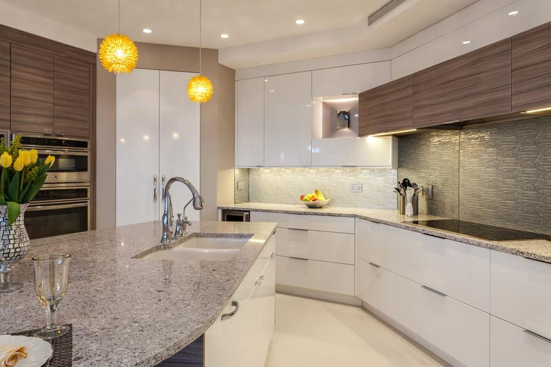 contemporary kitchen with glass front cabinets denver
