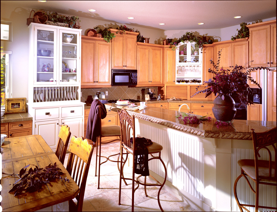 white painted cabinetry in this country kitchen