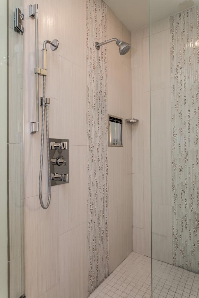 huge master shower with double heads and custom tile