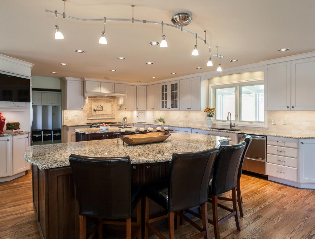 Lots of custom lighting in this gorgeous kitchen great room renovation project in Denver CO