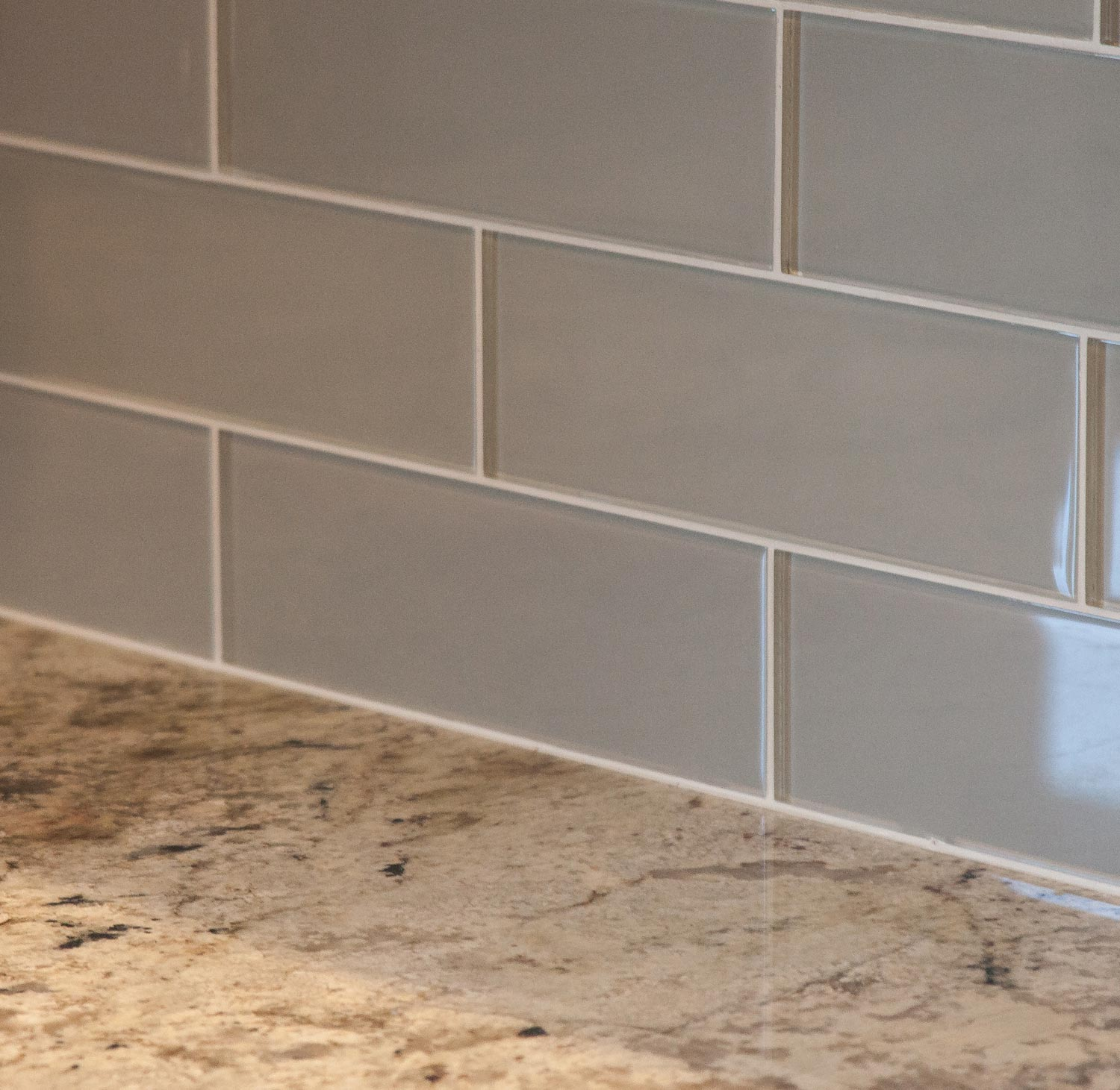 Castle Rock Builder Spec home with island subway tile and farm sink.