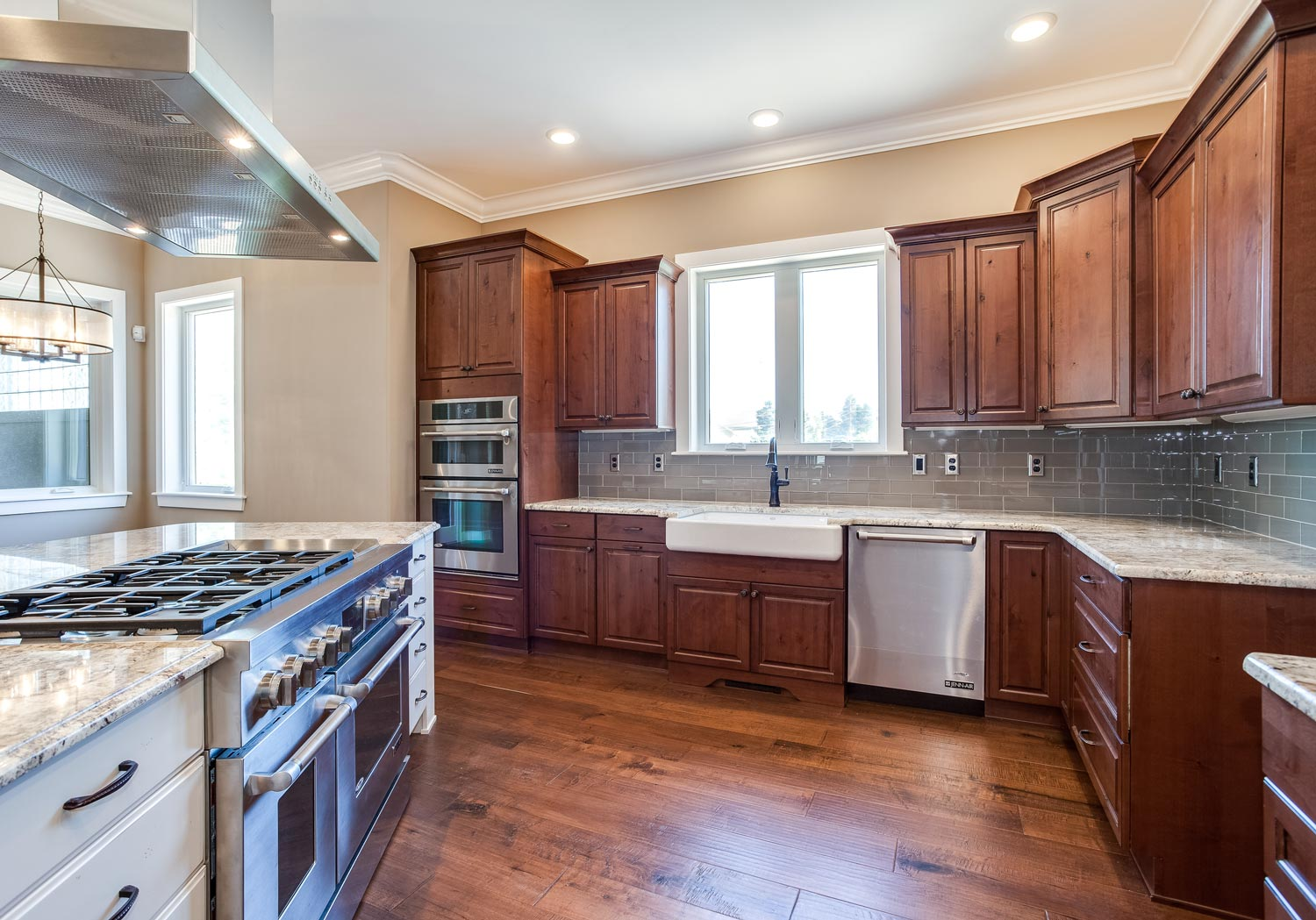 New center island kitchen design in castle rock jm for Kitchen center island cabinets