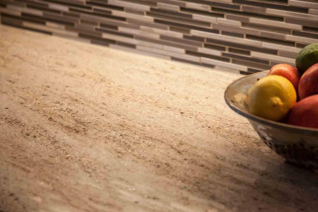 close up of granite countertop and glass subway tile backsplas in the remodel in cherry creek colorado