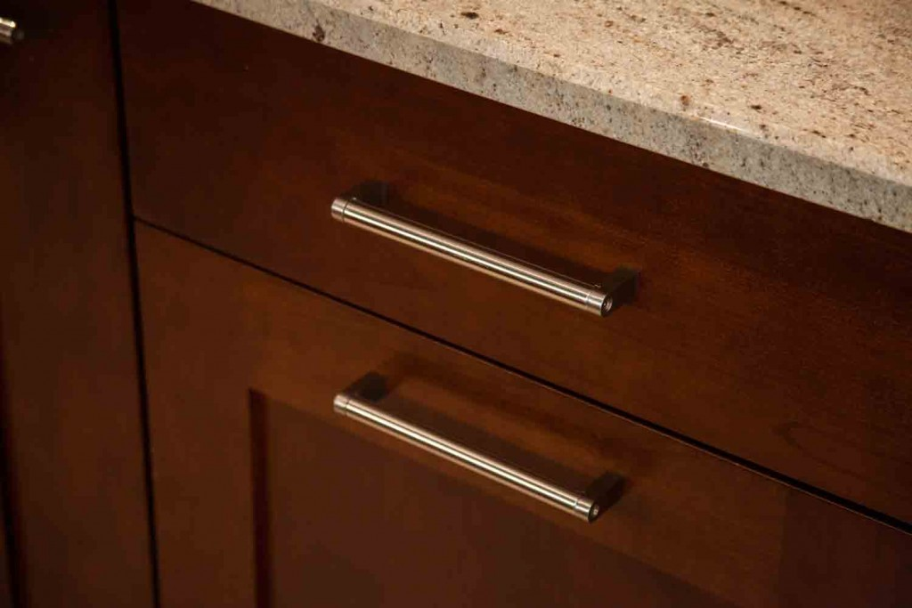 close up of cherry wood cabinetry and custom hardware in the remodel in cherry creek colorado