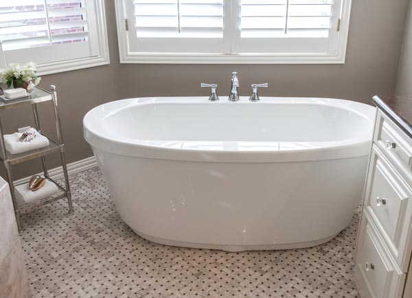 freestanding soaking tub in greenwood village remodeled bathroom photo