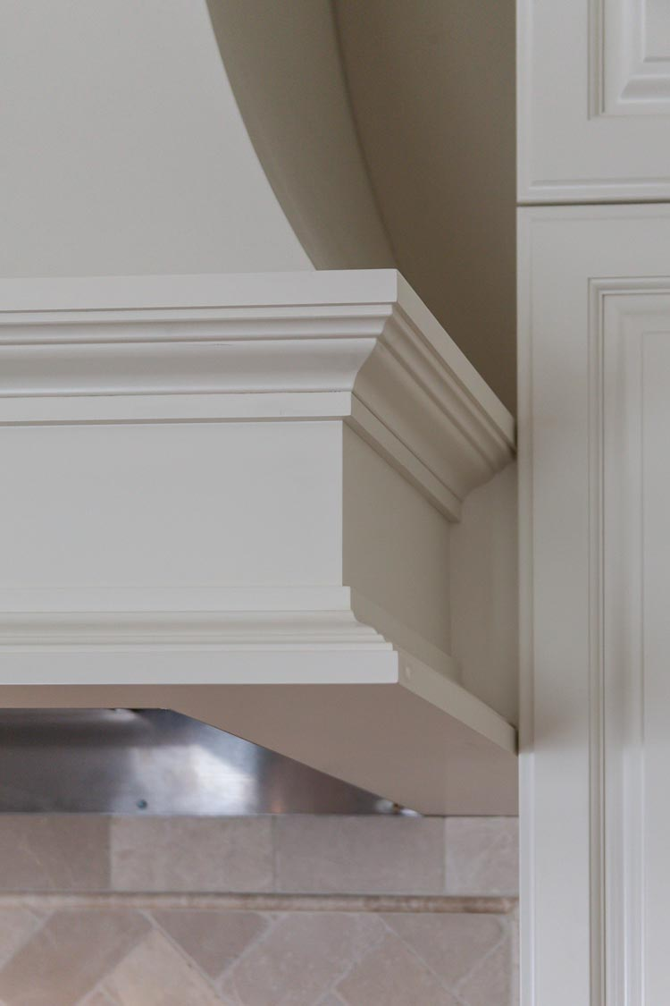detail of white stove hood in this denver greenwood village kitchen remodel