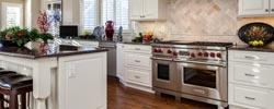 wolf range with red knobs in this Denver greenwood village kitchen remodel