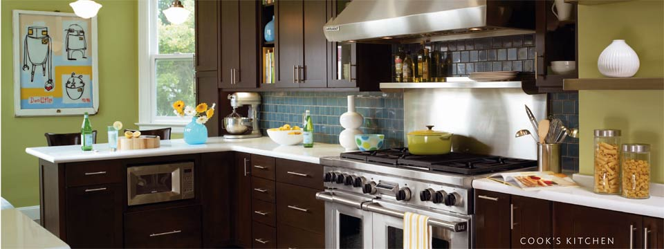 Bright Blue Tile on the backsplash accents this beautiful Shaker style kitchen
