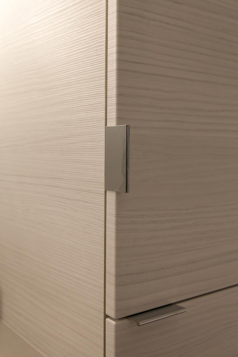 detail of glass fronted cabinets in master bath remodel