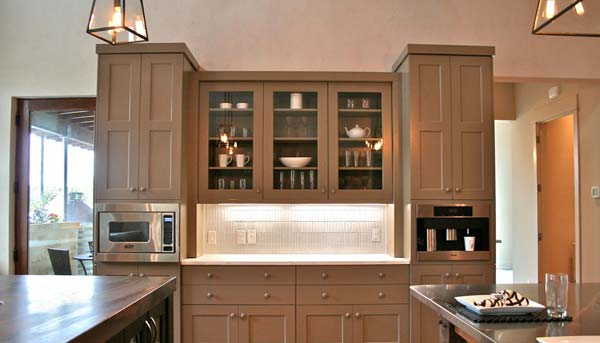 Crystal award winning kitchen by jennifer rogers features built in appliances.