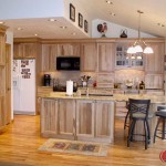 Custom kitchen natural wood cabinets, hardwood floors and eating space