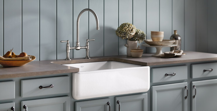 Deep bowl white farm sink sets off the grey painted cabinets in this shaker style kitchen.