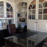 raised panel white cabinets are part of this beautiful home office