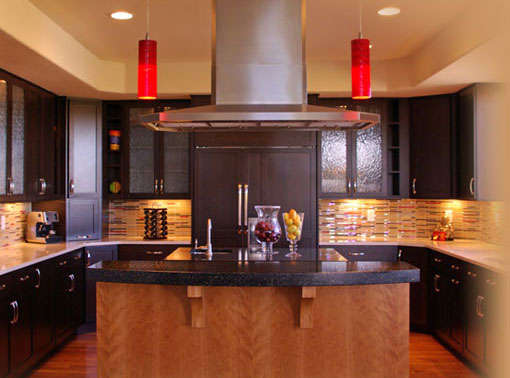 Modern Arts and Crafts Kitchen with custom island stove hood.