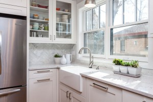 White Cabinets, Farm House Sink in Mid Century Modern Kitchen Remodel Denver