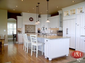 White Painted Cabinets with Hardwood Floors After Remodel