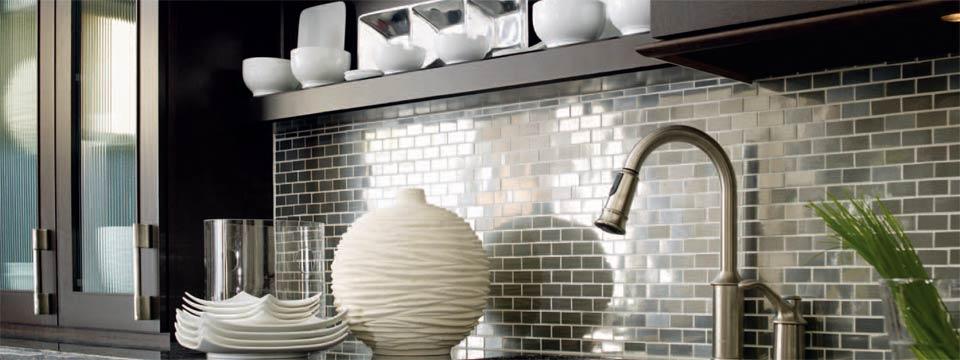 silver metallic backsplash detail in this modern kitchen remodel in Denver