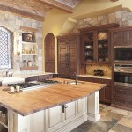 A huge wooden countertop sets off this one of a kind custom kitchen.