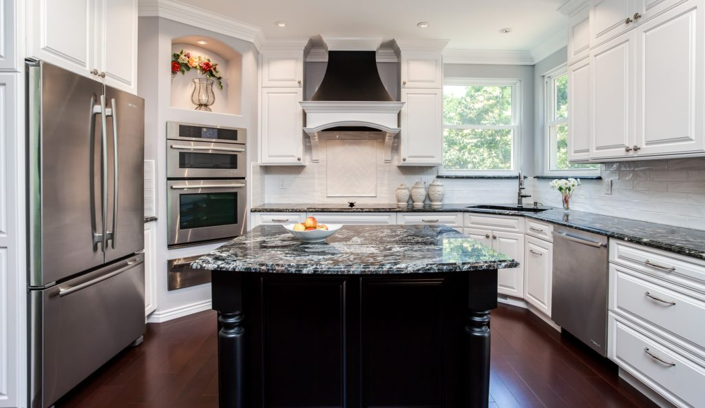 White cabinet kitchen with dark granite countertop