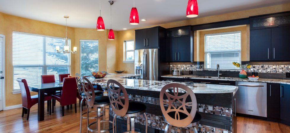 Black cabinet kitchen with unique tile backsplash