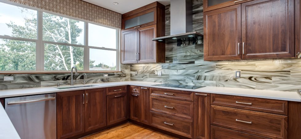 Dark wood cabinets with unique marble backsplash