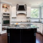 White cabinet kitchen with dark granite countertop