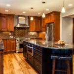 Natural wood cabinet kitchen with rounded island