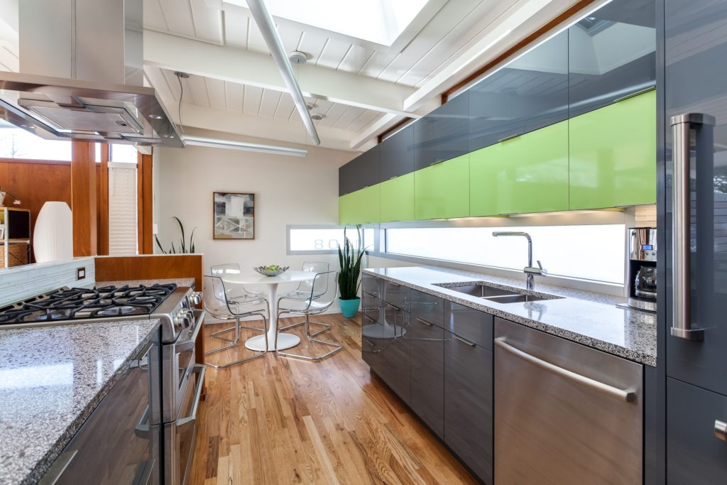 Sleek glass cabinets with stainless steel appliances