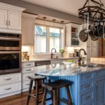 White painted cabinet kitchen with light blue painted island