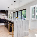 Contemporary Black Painted Cabinets with Gold Hardware