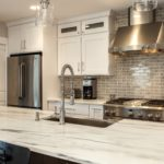 White kitchen cabinets with large vessel sink