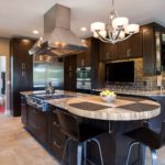Dark shaker cabinet kitchen with granite countertops