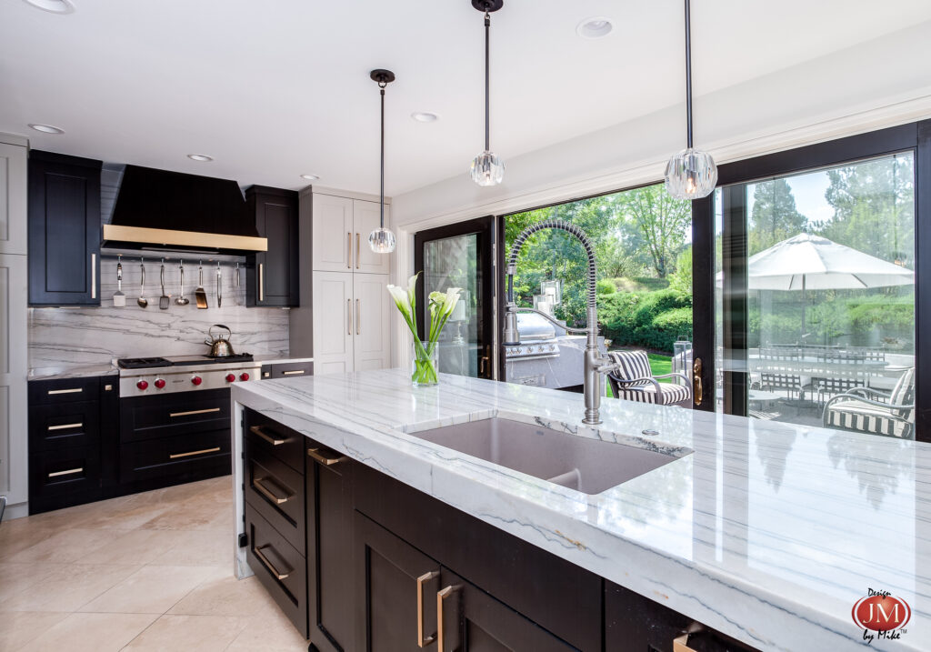 Views of the outdoor space surrounding this home are featured thorough the large glass windows from the greenwood village kitchen.