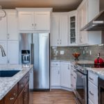 White cabinet kitchen with grey tile backsplash
