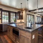 Dark wood cabinet kitchen with open beam ceiling