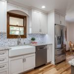 White painted cabinets with granite countertops