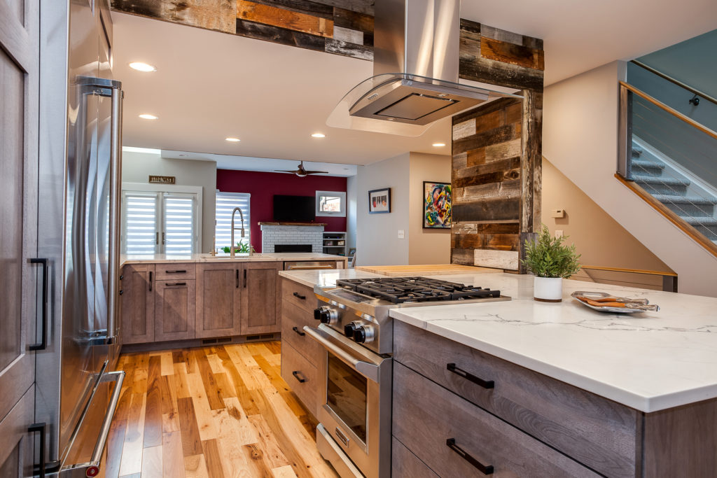 stainless steel Range hood  in this Denver Contemporary Kitchen Remodel by Juli