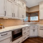Off white cabinets with granite countertop