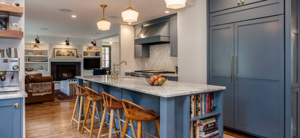 Muted blue painted cabinets with gold accents