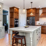 shaker kitchen with painted and wood cabinets in Castle Rock