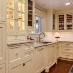 Off white shaker cabinets with textured glass