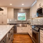 White shaker cabinet kitchen with tile backsplash