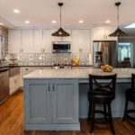 White and blue painted cabinets with granite countertop