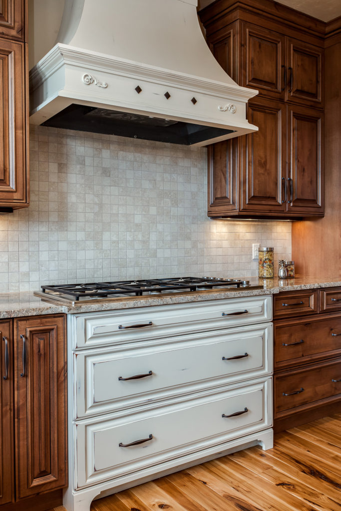 Range Hood is a Vent-A-Hood Liner with the surround made by Crystal Cabinetry