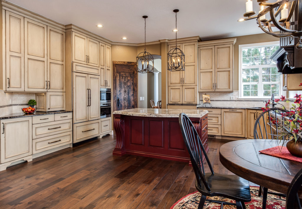 Expansive Distressed Painted Cabinet Kitchen Remodel with Wood Island