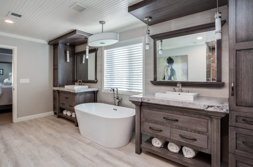 Master bath with custom built in vanities in natural wood