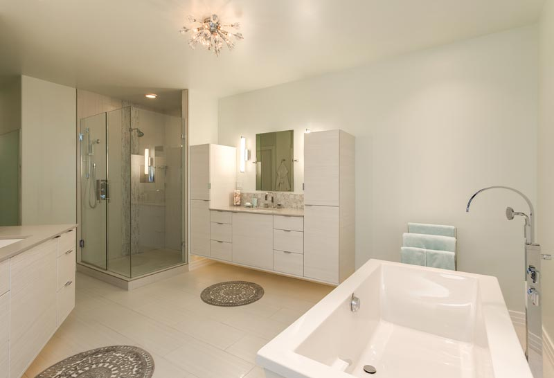 Modern bathroom with large tub and standing shower for better bathroom roi