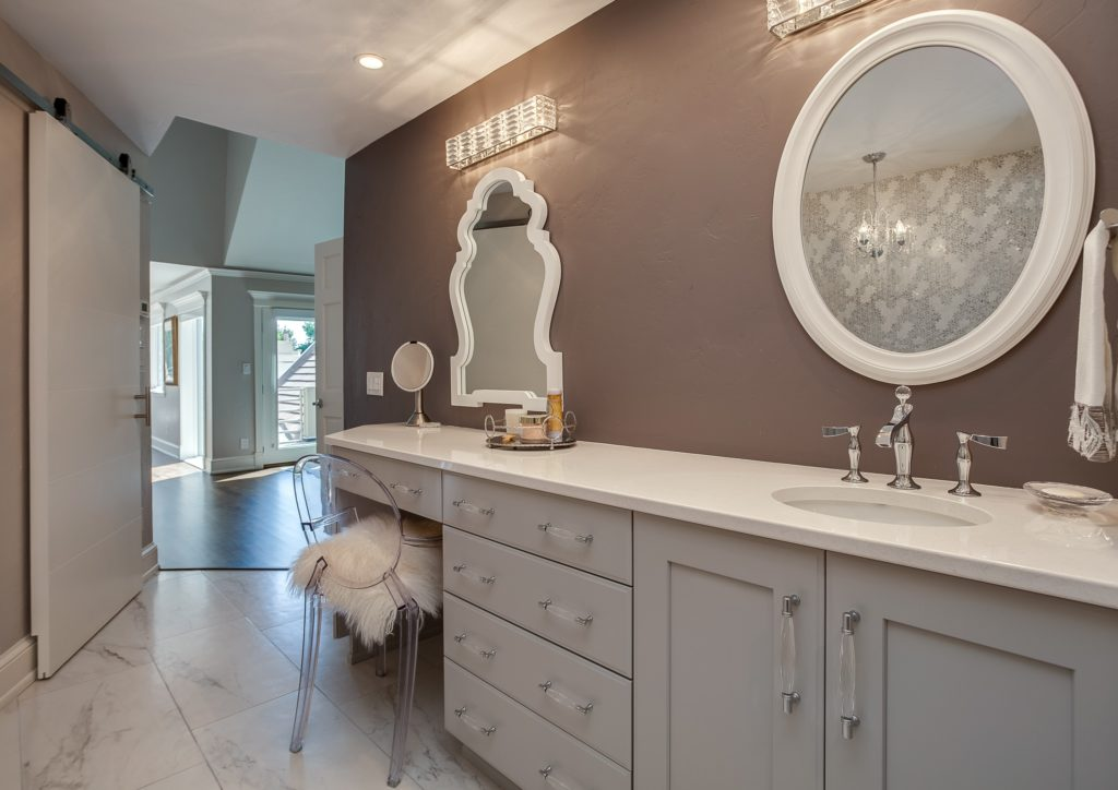 Master bath vanity with makeup mirror and chair